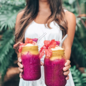 Woman holding two superfruit smoothies